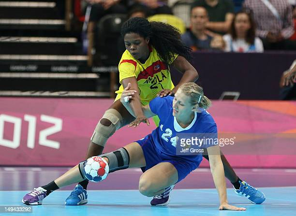 Magda Cazanga of Angola and Irina Bliznova of Russia compete for the ball in the Women's Handball preliminaries Group A Match 1 between Russia and...