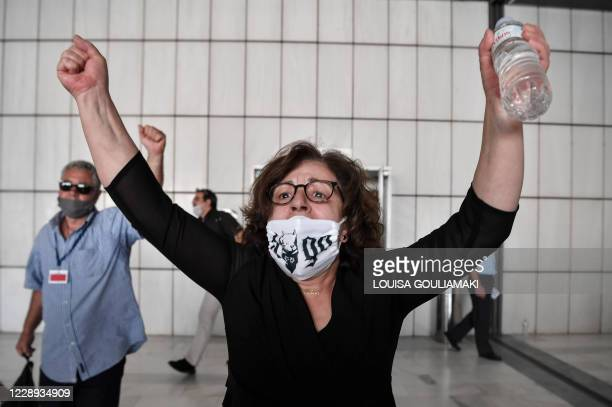 Magda Fyssa, the mother of murdered singer Pavlos Fyssas, reacts outside the courtroom following for the verdict in the trial of suspected members of...