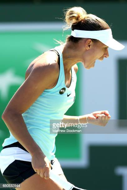 Magda Linette of Poland celebrates a point while playing Taylor Townsend during the BNP Paribas Open at the Indian Wells Tennis Garden on March 9...