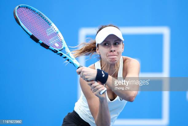 Magda Linette of Poland in action during the match against Shuai Zhang of China on Day 1 of 2020 WTA Shenzhen Open at Shenzhen Longgang Sports Center...