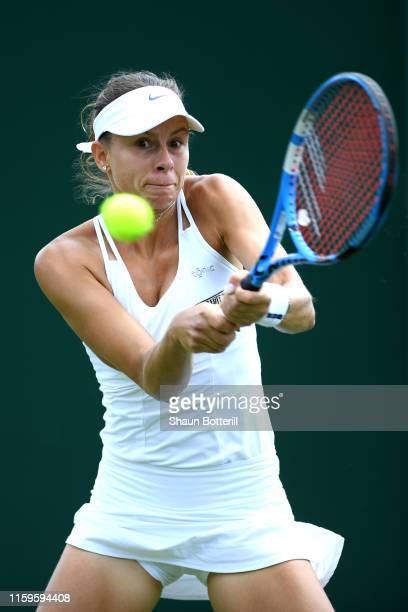 Magda Linette of Poland plays a backhand in her Ladies' Singles first round match against Anna Kalinskaya of Russia during Day two of The...
