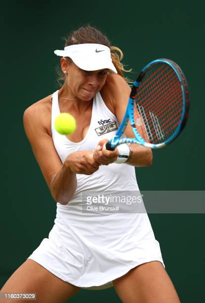 Magda Linette of Poland plays a backhand in her Ladies' Singles third round match against Petra Kvitova of The Czech Republic during Day six of The...