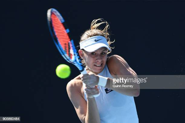 MELBOURNE AUSTRALIA Magda Linette of Poland plays a backhand in her second round match against Daria Kasatkina of Russia on day three of the 2018...