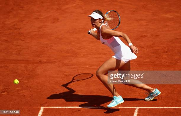 Magda Linette of Poland plays a forehand during the ladies singles third round match against Elina Svitolina of Ukraine on day eight of the 2017...