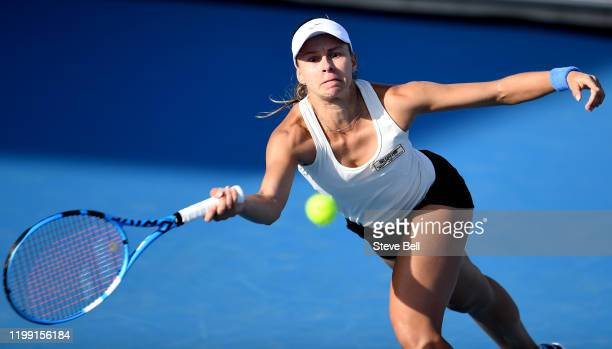 Magda Linette of Poland plays a forehand shot during her first round match against Svetlana Kuznetsova of Russia on day three of the 2020 Hobart...