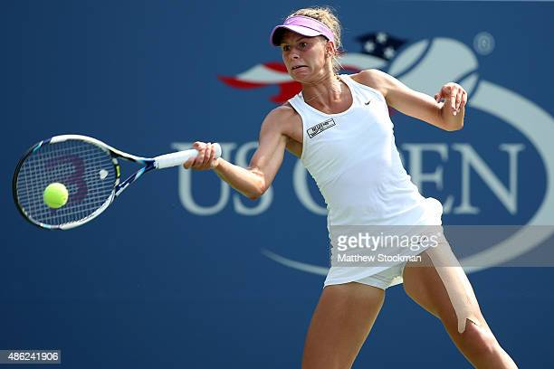 Magda Linette of Poland returns a shot against Agnieszka Radwanska of Poland in their Women's Singles Second Round match on Day Three of the 2015 US...