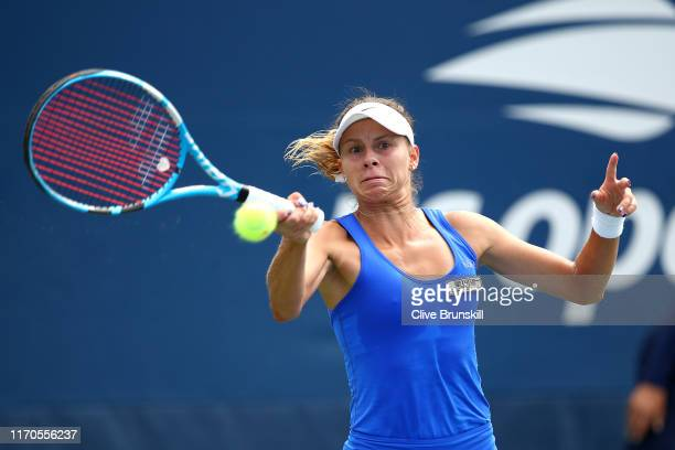 Magda Linette of Poland returns a shot against Astra Sharma of Australia during their Women's Singles first round match on day two of the 2019 US...