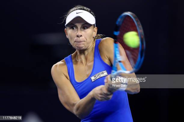 Magda Linette of Poland returns a shot against Sloane Stephens of the United States during women's singles first round match of 2019 China Open at...