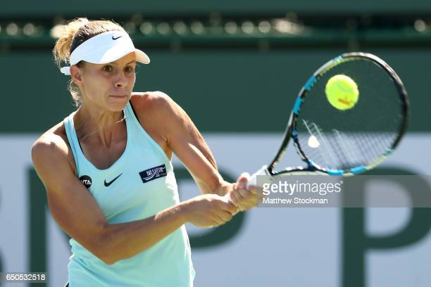 Magda Linette of Poland returns a shot to Taylor Townsend during the BNP Paribas Open at the Indian Wells Tennis Garden on March 9 2017 in Indian...