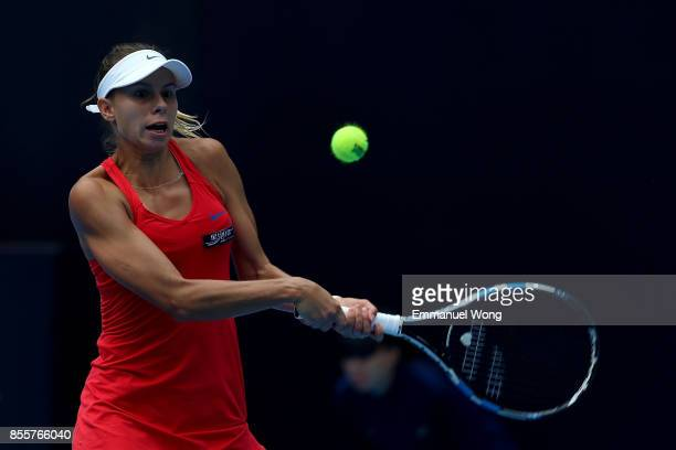 Magda Linette of Poland returns a shot to Xinyu Gao of China on day one of the 2017 China Open at the China National Tennis Centre on September 30...