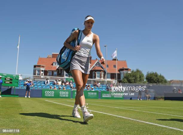 Magda Linette of Poland walks out onto court before her match against Petra Martic of Croatia in their Round One match during Day One of the Fuzion...