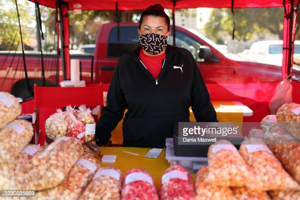 Magda Navarro poses for a portrait at a kettle korn stand at the farmers market in Whittier on Friday, Dec. 4, 2020 in Los Angeles, CA. Navarro said...