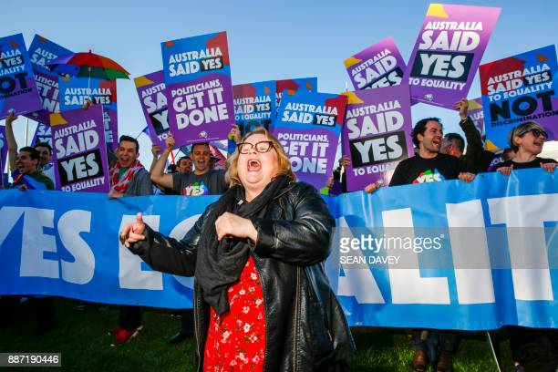 TOPSHOT Magda Szubanski dances in front of equality ambassadors and volunteers from the Equality Campaign gathering in front of Parliament House in...
