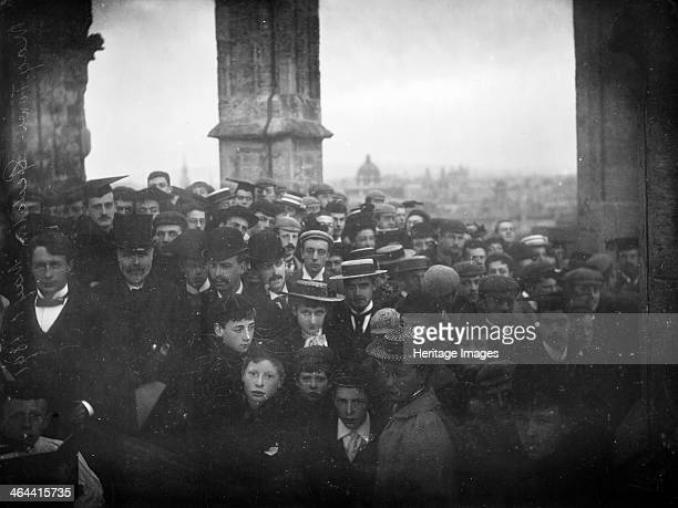 Magdalen College Oxford Oxfordshire 1895 Group of people including students celebrating May Day morning in the tower of Magdalen College