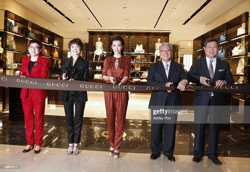 Magdalen Ho, Carol Shen, Li Bingbing and Wei Ying-chiao and Zhao Guo-shuai attend the ribbon cutting at the Gucci Flagship store opening at Taipei101 on November 22, 2012 in Taipei, Taiwan.
