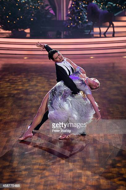 Magdalena Brzeska and Erich Klann perform during the Final of 'Let's Dance - Let's Christmas' TV Show on December 21, 2013 in Cologne, Germany.