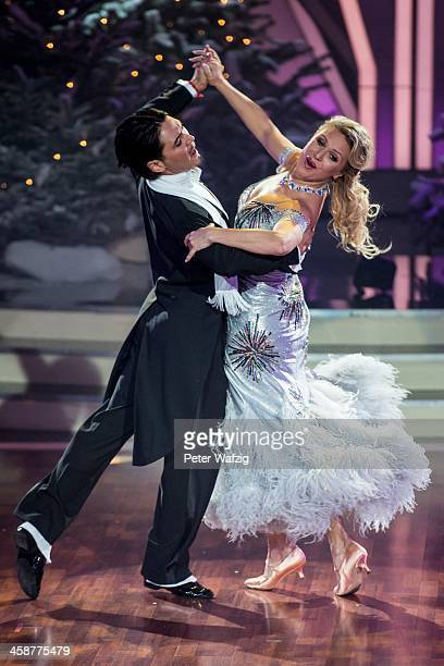 Magdalena Brzeska and Erich Klann perform during the Final of 'Let's Dance Let's Christmas' TV Show on December 21 2013 in Cologne Germany