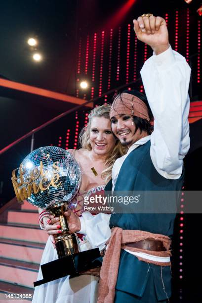 Magdalena Brzeska and Erich Klann pose for the photographers after winning the 2012 season of 'Let's Dance'TVShow at Coloneum on May 23 2012 in...