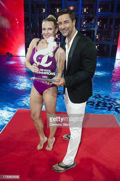 Magdalena Brzeska and Marco Schreyl pose with her award at the finals of the live show 'Pool Champions' on July 12 2013 in Berlin Germany