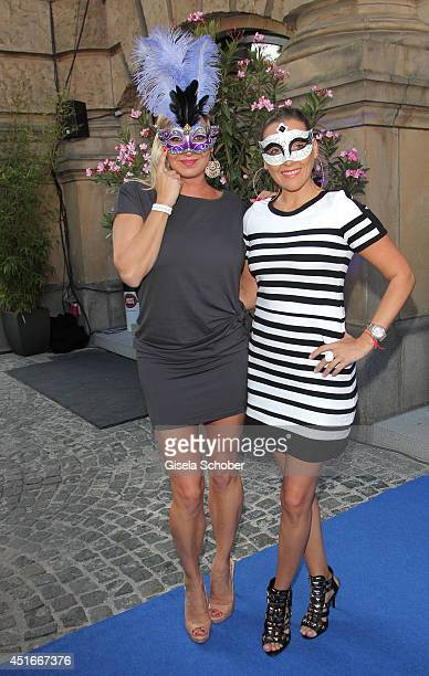 Magdalena Brzeska and Simone Ballack attends the CIROC VODKA Masquerade Night at Heart on July 3 2014 in Munich Germany