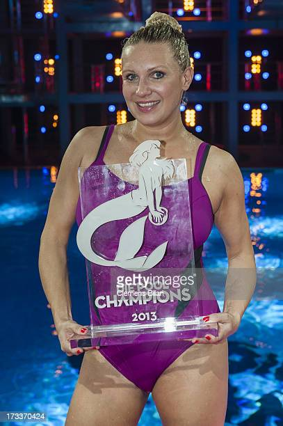 Magdalena Brzeska poses with her award at the finals of the live show 'Pool Champions' on July 12 2013 in Berlin Germany