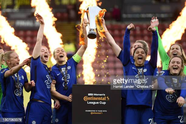 Magdalena Eriksson and Millie Bright of Chelsea lift the FA Women's Continental Tyres League Cup Trophy following their team's victory in the FA...