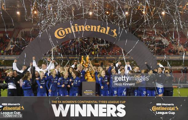 Magdalena Eriksson and Millie Bright of Chelsea lift the trophy following the FA Women's Continental League Cup Final between Chelsea FC Women and...