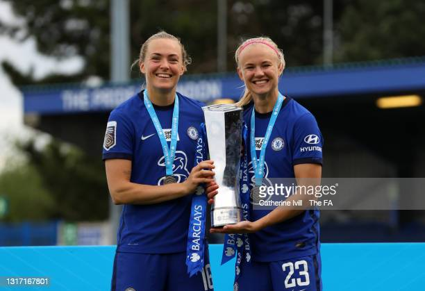 Magdalena Eriksson and Pernille Harder of Chelsea celebrate with the trophy after the Barclays FA Women's Super League match between Chelsea Women...