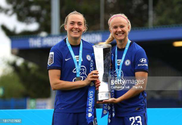 Magdalena Eriksson and Pernille Harder of Chelsea pose with the Trophy following the Barclays FA Women's Super League match between Chelsea Women and...