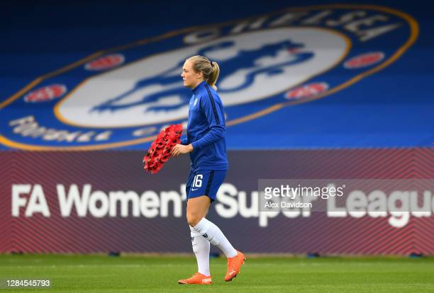 Magdalena Eriksson of Chelsea carries a Armistice Day poppy wreath out to the pitch prior to the Barclays FA Women's Super League match between...