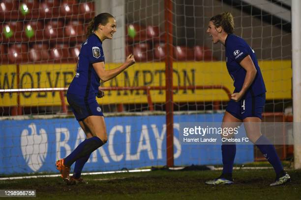 Magdalena Eriksson of Chelsea celebrates with teammate Millie Bright after scoring her team's fourth goal during the Barclays FA Women's Super League...