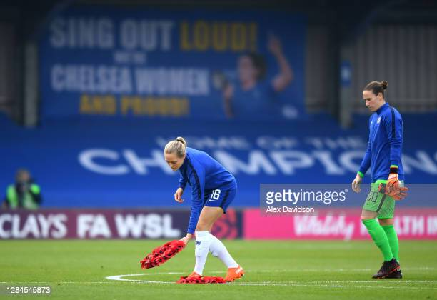 Magdalena Eriksson of Chelsea places a Armistice Day poppy wreath on the pitch prior to the Barclays FA Women's Super League match between Chelsea...
