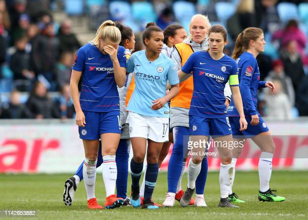 Magdalena Eriksson of Chelsea Women who scored an own goal to hand victory to Manchester City Women is consoled by Nikita Parris of Manchester City...