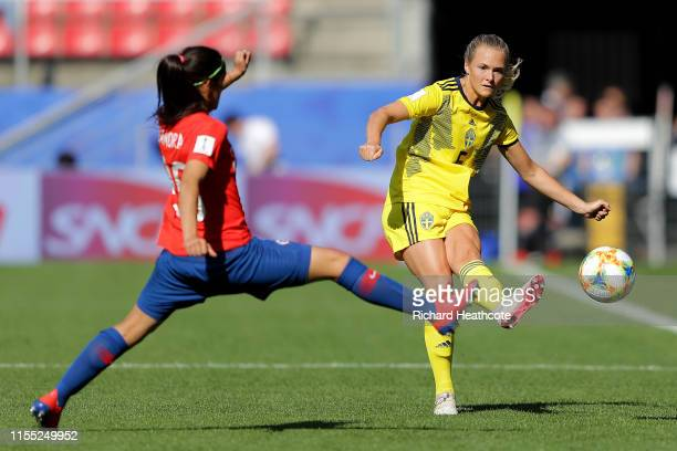 Magdalena Eriksson of Sweden passes the ball past Daniela Zamora of Chile during the 2019 FIFA Women's World Cup France group F match between Chile...