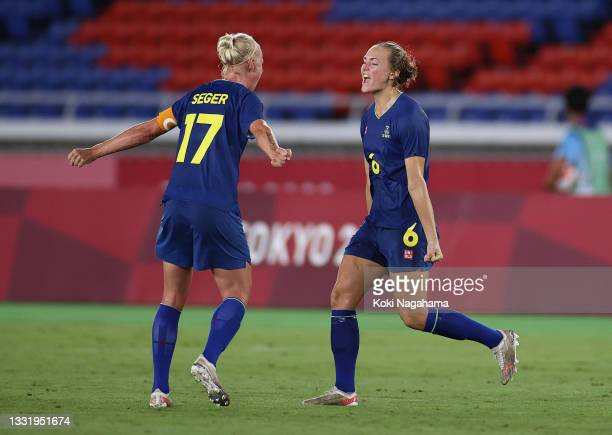 Magdalena Eriksson of Team Sweden celebrates their side's victory with Caroline Seger of Team Sweden after the Women's Semi-Final match between...