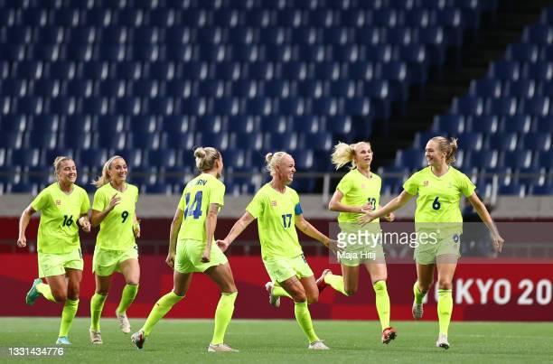 Magdalena Eriksson of Team Sweden celebrates with teammates Filippa Angeldal, Kosovare Asllani, Caroline Seger and Sofia Jakobsson after scoring...