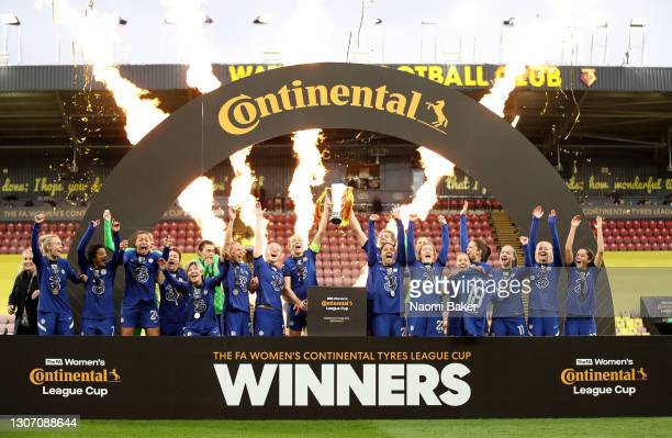 Magdalena Erkisson of Chelsea and Millie Bright of Chelsea lift the trophy after their teams victory during the FA Women's Continental Tyres League...