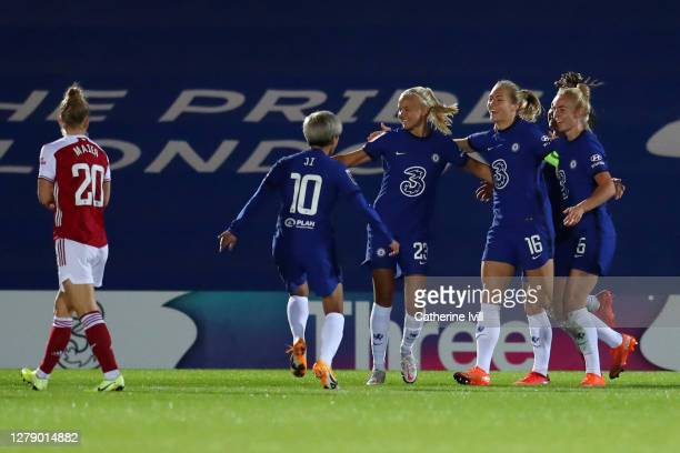 Magdalena Erkisson of Chelsea celebrates with teammates after scoring her sides first goal during the FA Women's Continental League Cup match between...