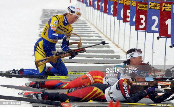 Magdalena Forsberg of Sweden prepares to shoot as Poiree Liv Grete Skjelbreid from Norway and Andree Henkel of Germany complete their turn at the...
