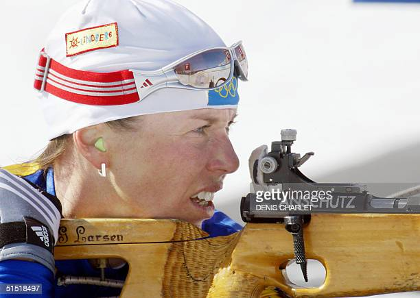 Magdalena Forsberg of Sweden shoots during the Women's 10km Pursuit Biathlon 16 February 2002 at the XIX Winter Olympic Games in Soldier Hollow Utah...