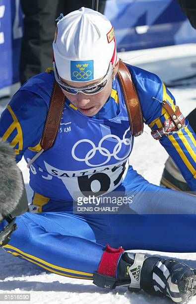 Magdalena Forsberg sits at the finish of the Womens 15 km Individual Biathlon 11 February 2002 at Soldier Hollow Utah during the XIXth Winter Olympic...