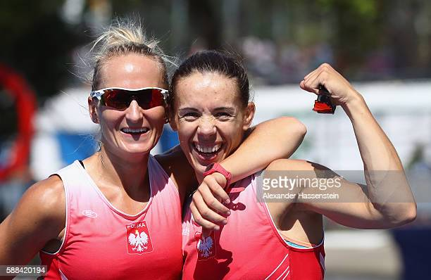 Magdalena FularczykKozlowska and Natalia Madaj of Poland celebrate after winning the gold medal in the Women's Double Sculls Final A on Day 6 of the...