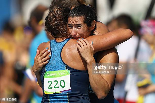 Magdalena Garro Brenda Rojas Sabrina Ameghino and Alexandra Keresztesi of Argentina react after the Women's Kayak Four 500m on Day 14 of the Rio 2016...