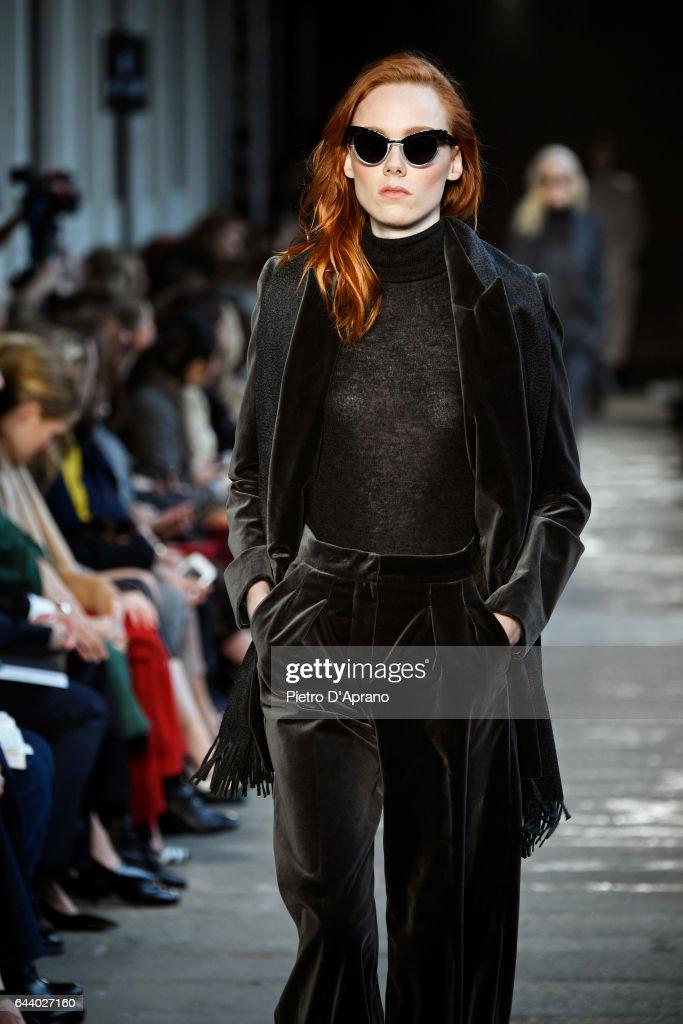 835d8d56ea Magdalena Jasek walks the runway at the Max Mara show during Milan ...