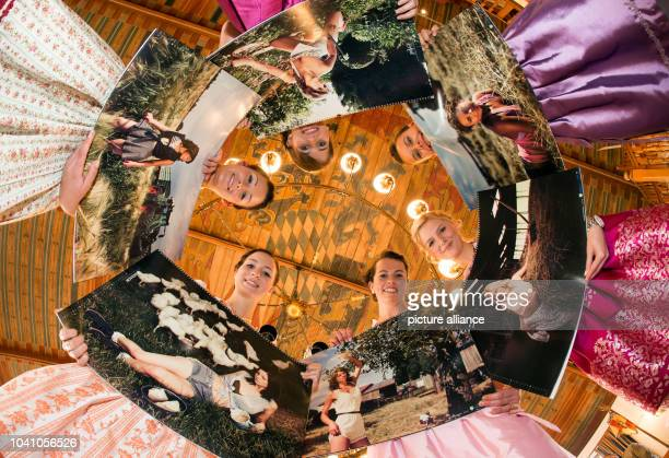 Magdalena Michelle Anna Kristina Franziska and Justine stand in a circle and present their calendar pages in Munich Germany 07 October 2014 Each of...