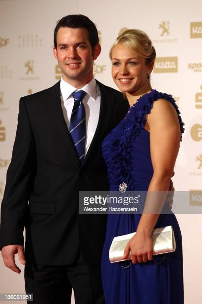 Magdalena Neuner arrives with Josef Holzer for the 'Athlete of the Year 2011' gala at the Kurhaus Baden-Baden on December 18, 2011 in Baden-Baden,...