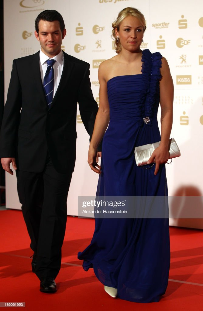 Magdalena Neuner arrives with Josef Holzer for the 'Athlete of the Year 2011' gala at the Kurhaus Baden-Baden on December 18, 2011 in Baden-Baden, Germany.