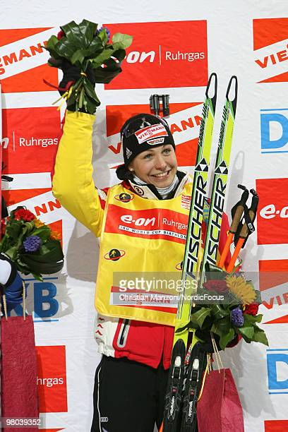 Magdalena Neuner celebrates as overall leader after the women's sprint in the EOn Ruhrgas IBU Biathlon World Cup on March 25 2010 in KhantyMansiysk...