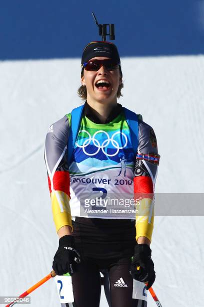 Magdalena Neuner of Germany celebrates winning gold in the women's biathlon 12.5 km mass start on day 10 of the 2010 Vancouver Winter Olympics at...