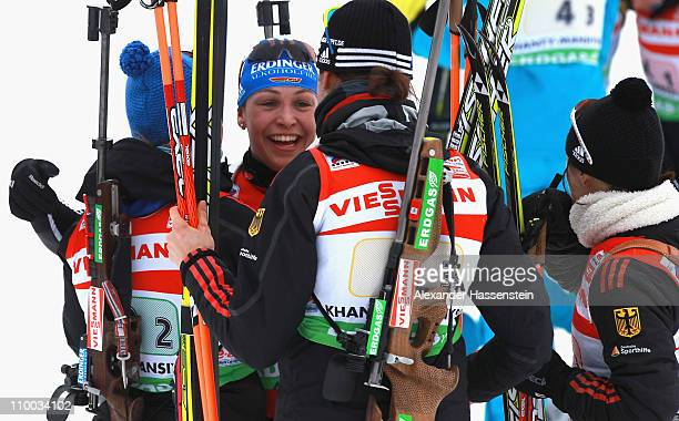 Magdalena Neuner of Germany celebrates winning the gold medal with her team mates Andrea Henkel Miriam Goessner and Tina Bachmann at the finish area...
